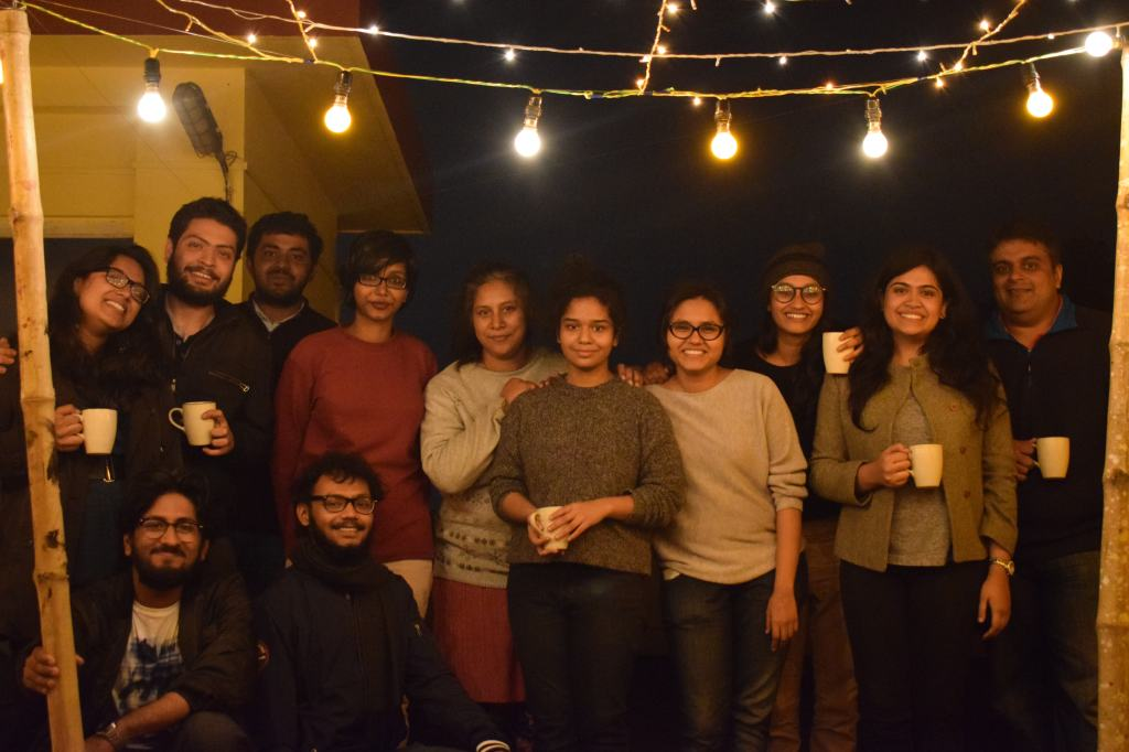 Smiling people with mugs in their hands after a meal at Wine and Wasabi's pop-up